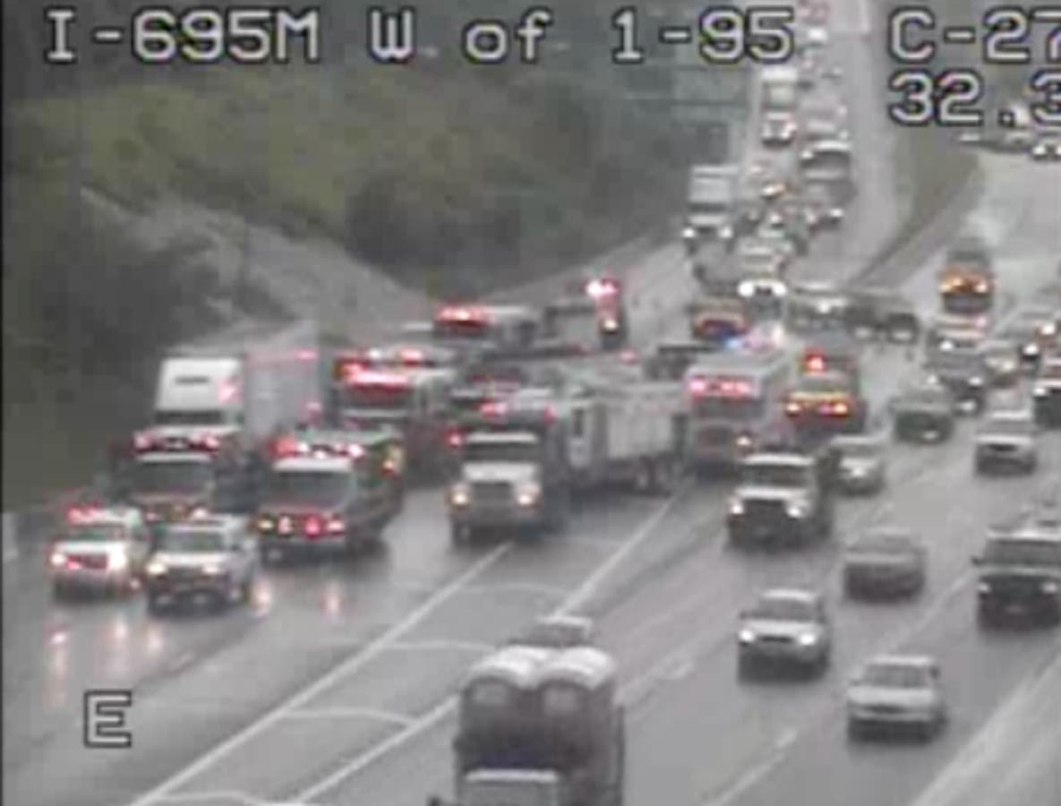 SUV Trapped Under Tractor-Trailer On I-695: Officials