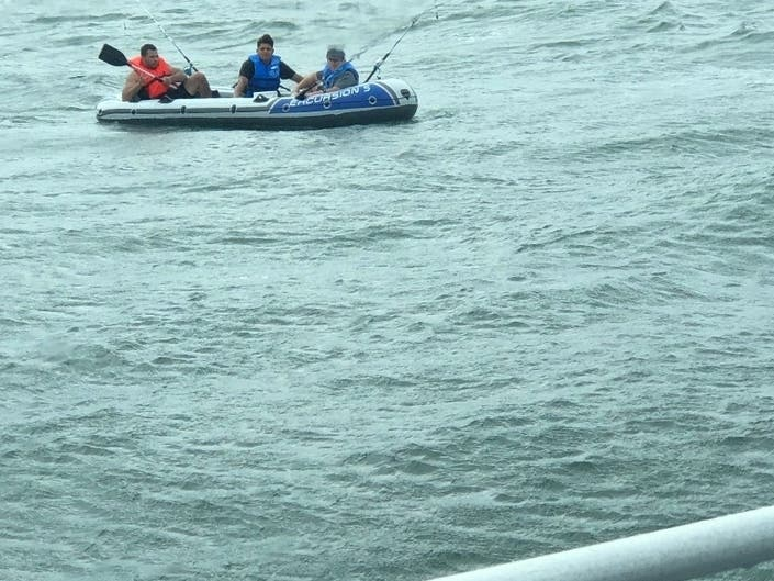 Officers Rescue 3 Men Who Drifted from Shore in Inflatable Raft