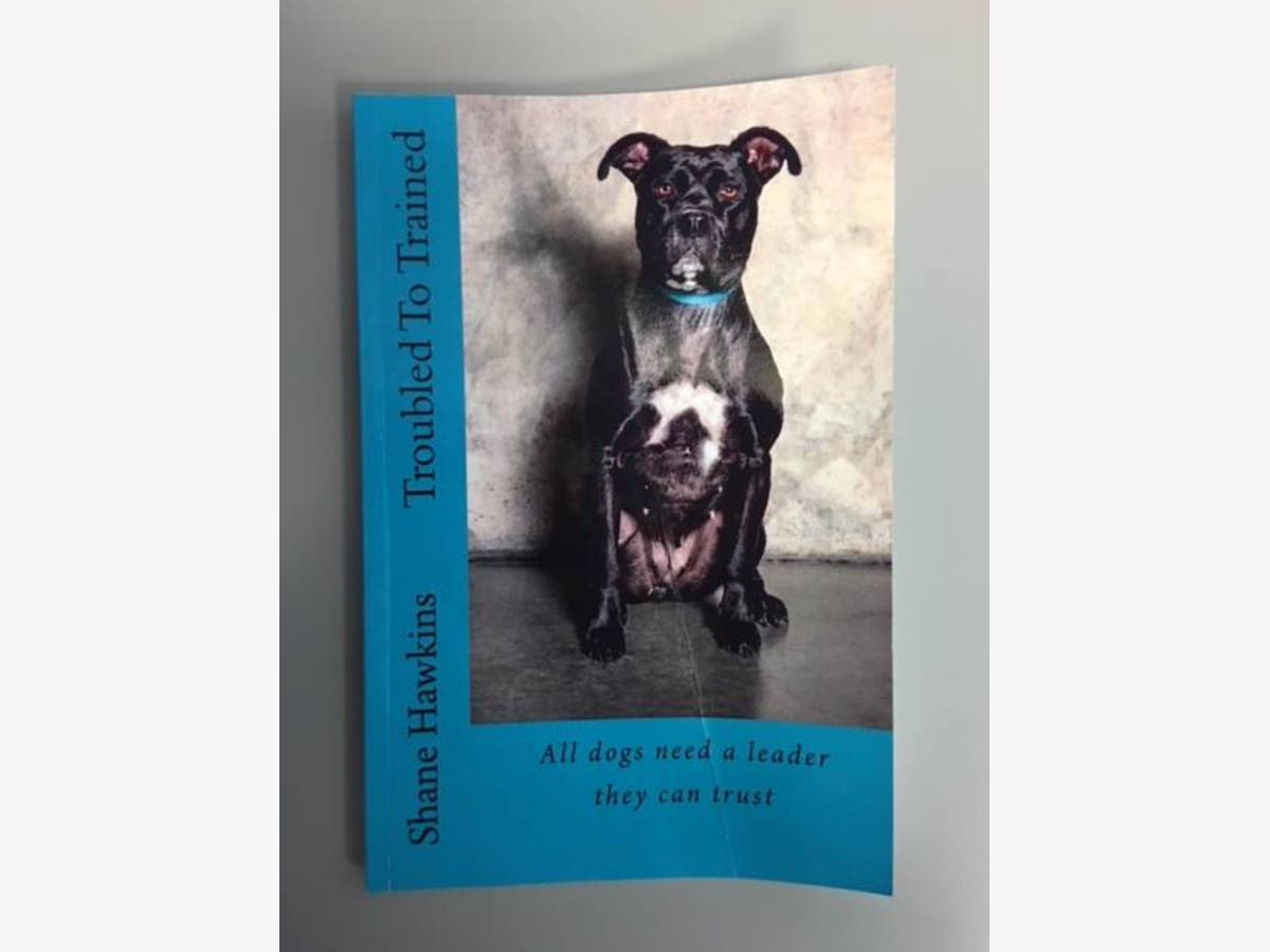 Gwinnett Inmate Trains Dogs, Writes Book 'Troubled To Trained